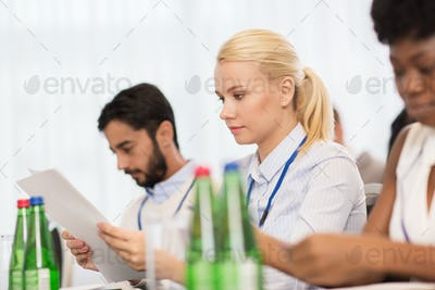 businesswoman with files at conference