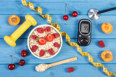 Glucometer, oat flakes with fruits, dumbbells and centimeter
