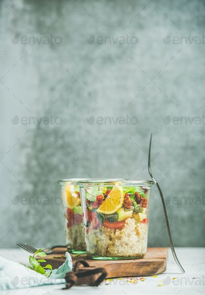 Healthy salad with quionoa, avocado, dried tomatoes, basil and orange
