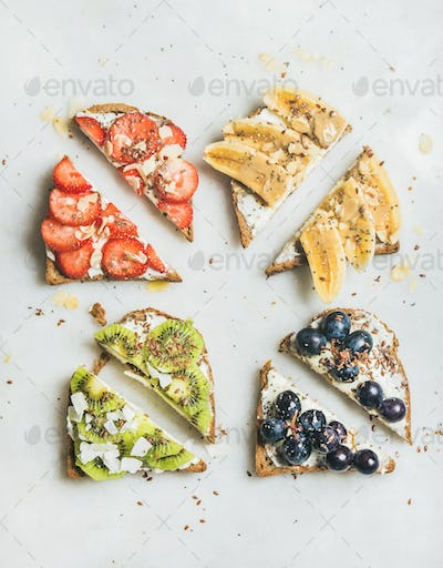 Healthy breakfast wholegrain toasts with cream-cheese, fruit, seeds, nuts