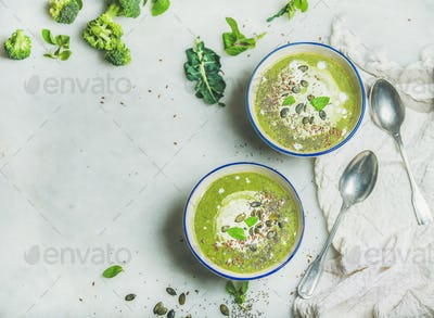 Broccoli cream soup with mint and coconut cream, copy space