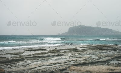 Stormy winter day with waves at Mediterranean sea, Alanya, Turkey