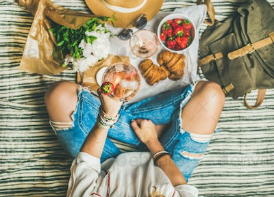 Outdoor gathering concept with wine and french snacks on blanket