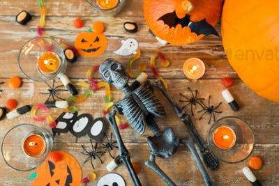 halloween decorations and candies wooden boards