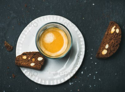 Glass of coffee espresso with chocolate and sea salt biscottii