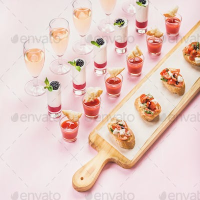 Catering, banquet food concept over pastel pink background