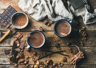 Hot chocolate with cinnamon sticks, anise, nuts and cocoa powder