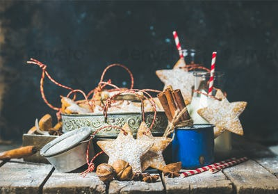 Christmas star shaped cookies, decoration rope, nuts, spices, milk bottles