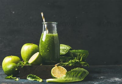 Smoothie with apple, romaine lettuce, lime, mint, dark blue background
