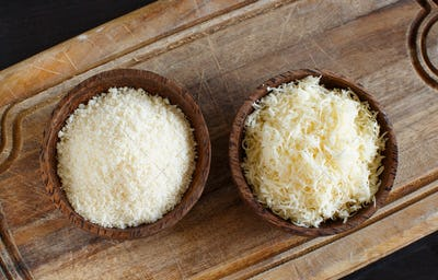 Bowls with grated parmesan cheese