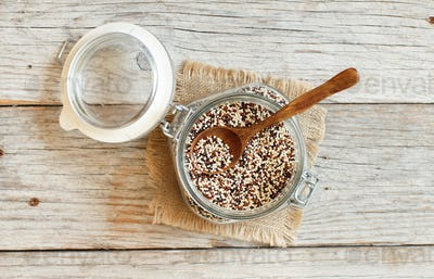 Uncooked mixed quinoa grain in a glass
