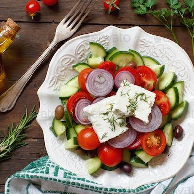 Greek salad and ingredients top view