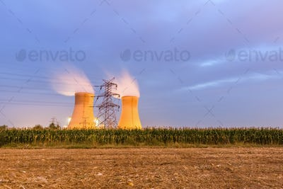 power plant on farmland at night