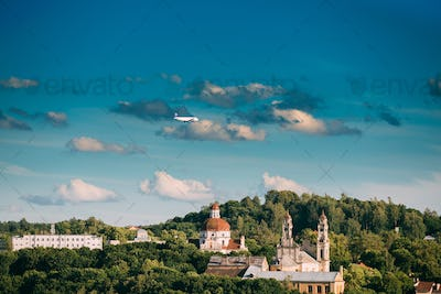 Vilnius, Lithuania. Plane Flying Over Church Of The Ascension An