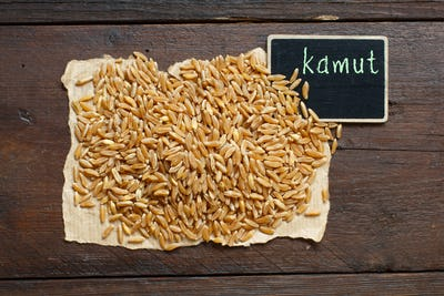 Pile of Kamut grain with a small chalkboard