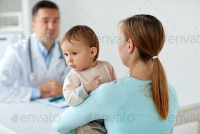 happy woman with baby and doctor at clinic
