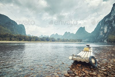 Retro toned picture of a bamboo raft on Li River, China.