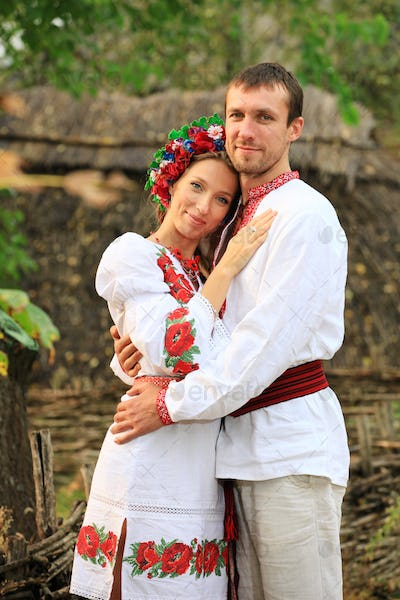 Lovely couple in Ukrainian style clothing outdoors