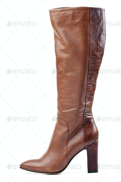 Brown knee high boot isolated over white