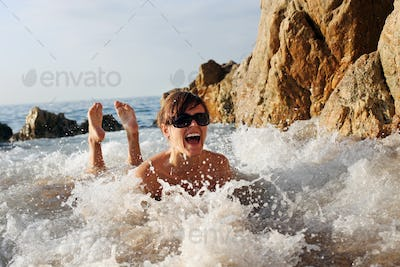 Young Caucasian female having fun at the sea shore
