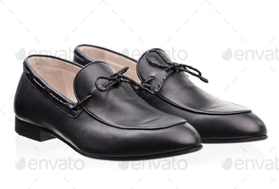 Pair of elegant male shoes over white background
