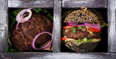 Black big sandwich -  black hamburger with juicy beef burger