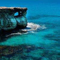 Rocky coastline and sea cave in Ayia Napa, Cyprus