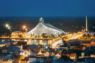 Riga, Latvia. Aerial View Of Cityscape In Summer Evening Or Nigh
