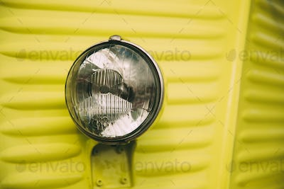 Close Up Of Old Vintage Retro Classic Cars Headlight