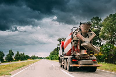 Special Concrete Transport Truck Unit In Motion On Country Road,