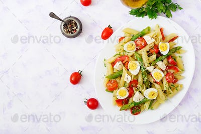Salad - penne pasta with asparagus, tomatoes, quail eggs, mozzarella