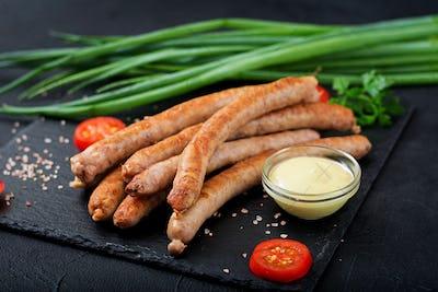 Grilled sausages on dark background. Oktoberfest.