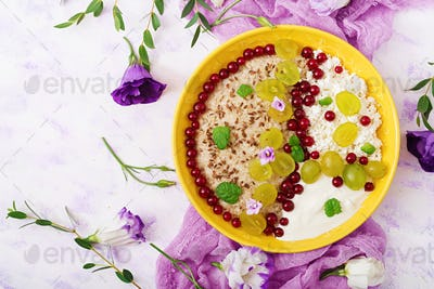 Delicious and healthy oatmeal with grapes, yogurt and cottage cheese