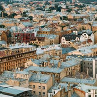 Riga, Latvia. Top View On Old Rusty Roofs Old Houses