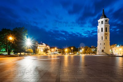 Vilnius, Lithuania. Night Or Evening View Of Bell Tower Near Cat