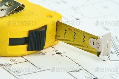 A measuring tape on a drawing