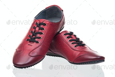 Red female shoes over white