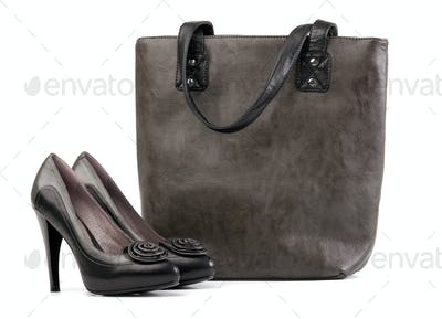 Pair of black female shoes and handbag