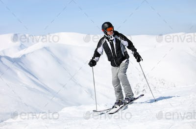 Portrait of skier on mountain slope