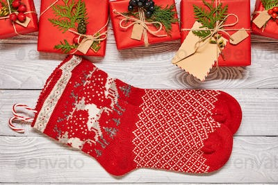 Christmas presents and stockings on wooden background