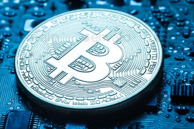 Virtual currency is the golden bitcoin on background of printed