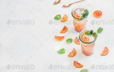 Blood orange fresh summer lemonade in glasses, copy space