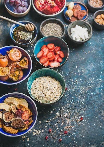 Ingredients for healthy vegetarian breakfast over dark blue plywood background