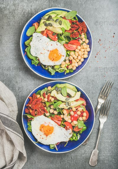 Clean eating concept breakfast with fried egg, chickpea, vegetables, seeds