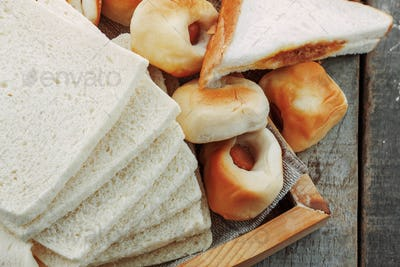 Many breads on wooden