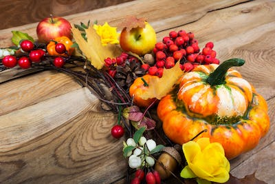 Fall decor with pumpkin and red berries, copy space