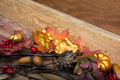 Thanksgiving background with golden pumpkin and acorn wreath, co