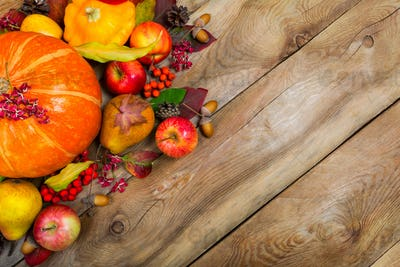 Thanksgiving background with pumpkin, apples and fall leaves, co