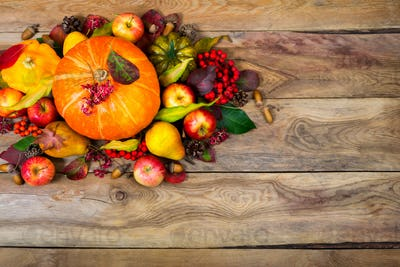 Thanksgiving arrangement with pumpkin, apples, pears, rowan berr
