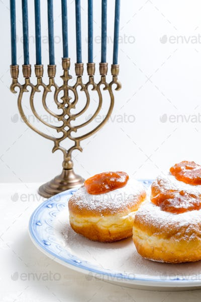 Hanukkah Minor, donuts with jam on a plate close-up